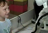 A child interacting with a socially assistive humanoid robot developed in the Interaction Lab